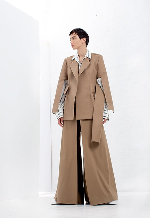 Khaki tailored jacket with cut-out sleeves, Ivory oversized Celia poetry blouse, khaki cotton wrap pant